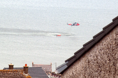 A search and rescue helicopter, seen offshore of Whitehaven.