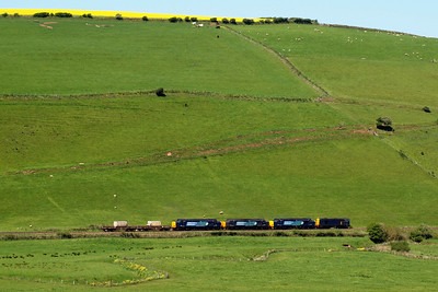 Lush green fields are passed by the four loco convoy of 6C46 on its way from Sellafield to Carlisle Kingmoor, at Low Walton.