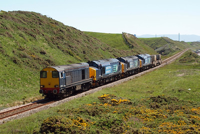20302 and friends pass Nethertown, with the gorse coming into bloom, 26/05/12.