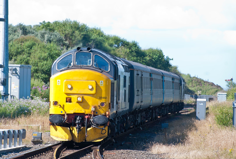 On July 25th 2015 37 402 is at the head of a southbound working as it slows for Whitehaven station. I'd spent the earlier part of the day cycling some of the disused railways that used to carry ore traffic down from the foothills of the Lake District hills.