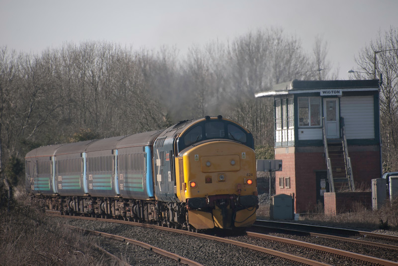A postscript from the same year - 2018 - which was the last year of Class 37s on the Cumbrian Coast.  A weekend in Carlisle allowed for a quick jaunt to Wigton on the Vulcan bomber tribute  37558. Looking immaculate at the rear of the formation as it passes Wigton signal box. 24th Feb 2018 so nine days since the second set went over to class 68 operation. Regular use of class 37s ended on the 21st May 2018.