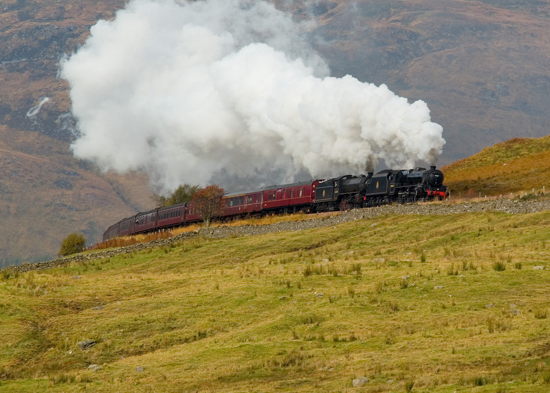 12th October 2009. With the Fort William to Mallaig Jacobite season over, Black 5 45407 & K1 Class 62005 (masquerading as 62034) and the empty coaching stock head back to Carnforth in Lancashire. Seen here entering the Horseshoe Curve, between Bridge of Orchy and Tyndrum Upper.