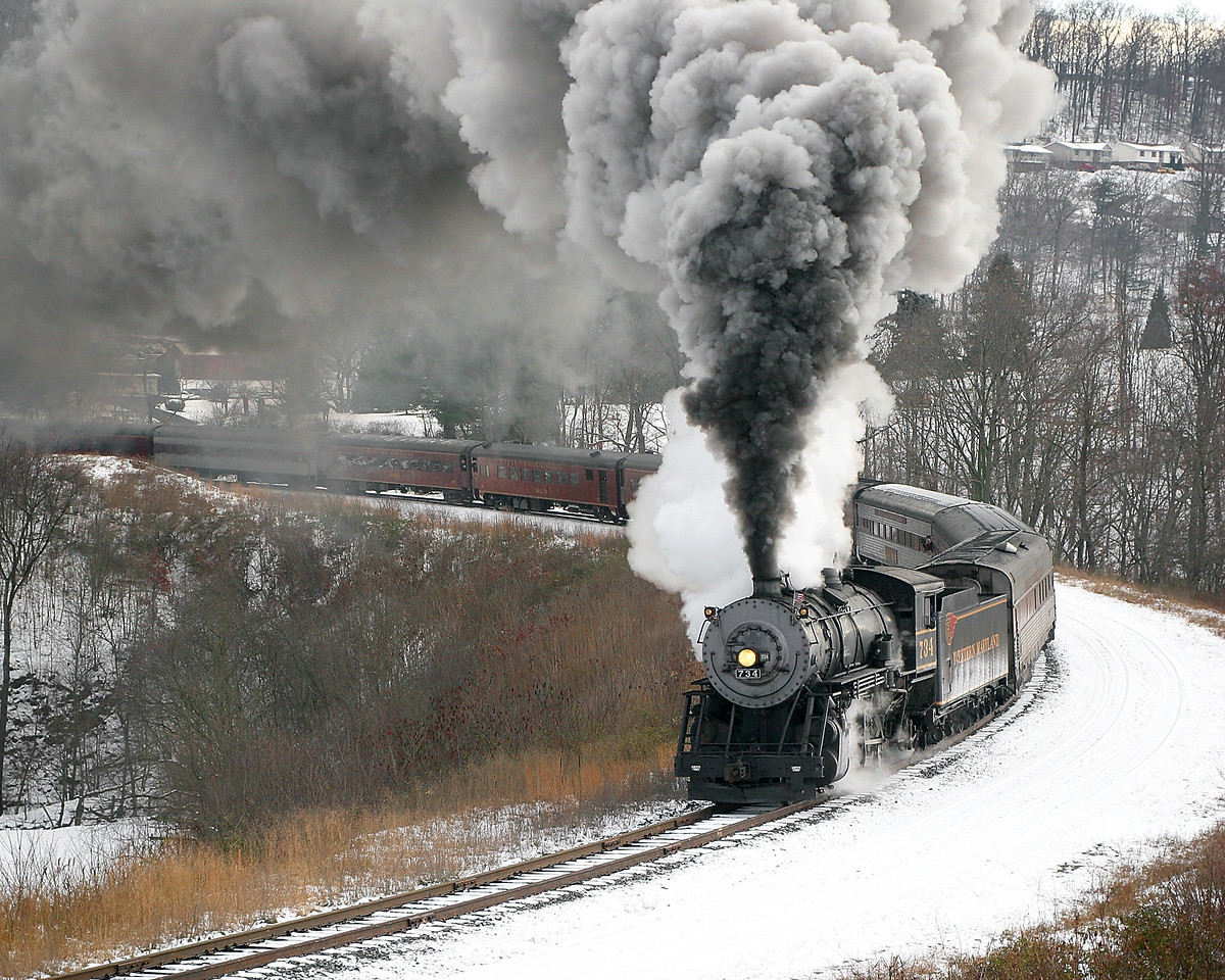 #734 rounds Helmstetter's Curve on a snow December day Western Maryland Scenic Railroad