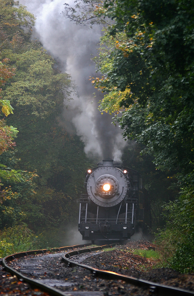 Steam engine #734 approaching Frostburg in the rain Western Maryland Scenic Railroad