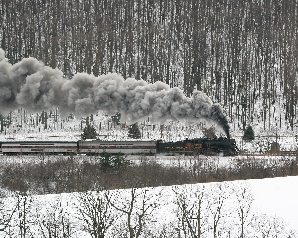 Long view of #734 steam engine in the snow Western Maryland Scenic Railroad