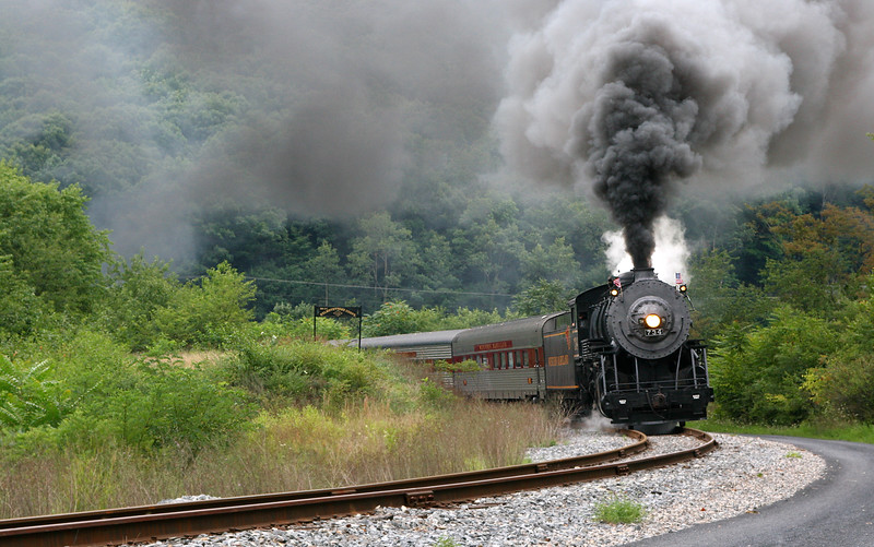 WMSR #734 passes the Helmstetter's Curve sign Western Maryland Scenic Railroad