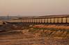 Loaded coal train hoppers on Crawford Hill, Nebraska at sunset. October 2003