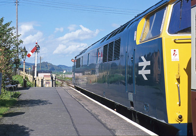 In the year 2000, D1023 'Western Fusilier' visited the West Somerset Railway for a diesel gala. Here the driver is glimpsed looking for the right-away at Blue Anchor.
