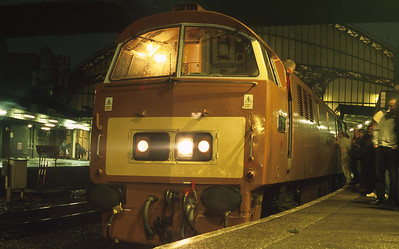At Bristol Temple Meads on a wet evening, passengers gather round D1015.