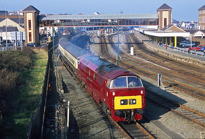 Twin plumes of exhaust show that D1015 is leaving the carriage sidings at Holyhead after the stock for this special to North Wales has been watered. So much more dramatic than the single vertical exhaust of a Sulzer engined type 4.