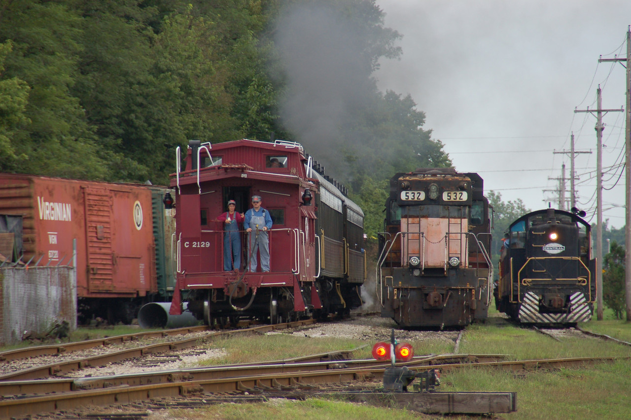 The yard of the WVRR is a busy place on weekends. <br /> (That's me (on the right) on the caboose.