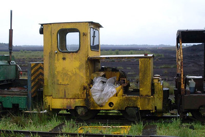 A side view of the youngest locomotive on site, Alan Keef No 26 of 1988, sitting on the scrap line.