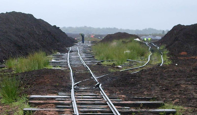 "Looking the other way, in a southerly direction. The line on the left is the ""main line"", the one ofn the right was being used by the empty trains to return to the stockpile of peat being collected."