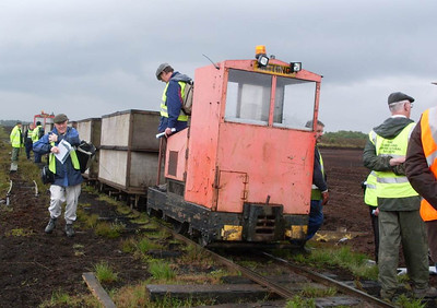 Irthing, a seventy year old locomotive (Motor Rail 8655/1941) surrounded by members of the Cumbrian Railway Association as it waited for another loco to clear the line from the peat stack.