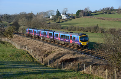 185103 forms the 12.02 Windermere-Oxenholme seen between Staveley and Burneside 28/12/14.