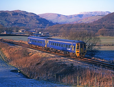As the sun sets 158753 departs Staveley with a train from Windermere 27/12/00.