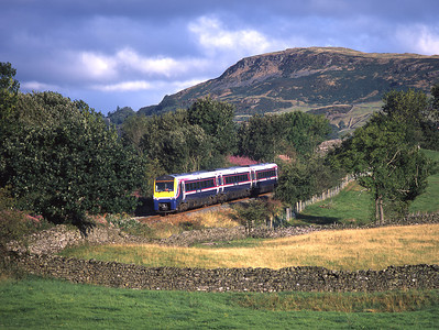 175111 is seen between Staveley and Burneside with a Windermere branch shuttle 29/8/03.