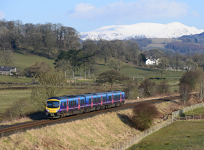185121 forms the morning school train 07.55 Windermere-Oxenholme between Burneside and Kendal 21/3/13.