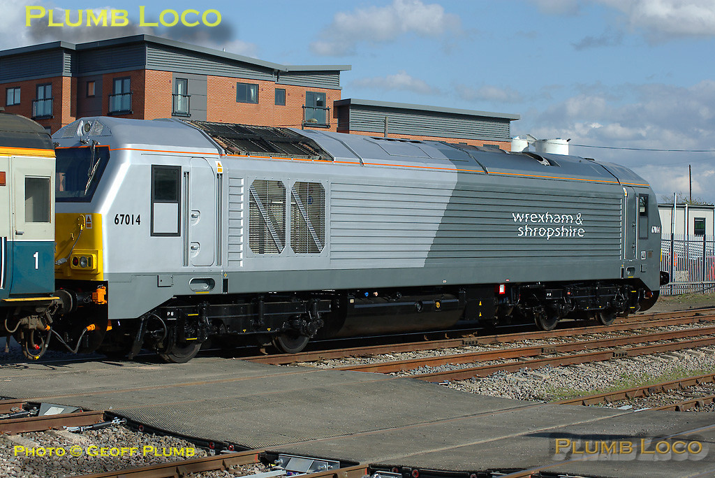 Wrexham & Shropshire Railway Class 67 No. 67014, newly outshopped from Toton in its dedicated livery is stabled on one end of the crew training train in the sidings at Banbury station, Friday 11th April 2008. Digital Image No. IMGP4483.