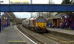 "Another week of crew training runs for the Wrexham & Shropshire trains commenced with the afternoon working, 5Z23, 14:02 Banbury to Marylebone on Monday 3rd March 2008. The pairing of locos had changed, 67016 being replaced by 67002 ""Special Delivery"" whilst 67017 ""Arrow"" remained with the train but now on the northern end. The two locos and their three Mk.III coaches pass through Saunderton station, where it was trying to snow, at 14:42. Digital Image No. IMGP3972."