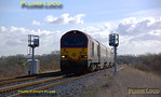 The morning return run of the WS&MR crew trainer, 5Z10, 10:17 from Marylebone to Banbury, is difficult to photograph when the sun is out as for almost the whole length of the journey the camera is looking straight into the sun. Here the train is seen from a public footpath across the line at Launton, just south of Bicester, with 67016 leading and 67017 on the rear. The line here is signalled bi-directionally. 11:12, Wednesday 27th February 2008. Digital Image No. IMGP3936.