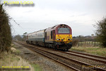 "The WS&MR trainer ran for the second time on the afternoon of Monday 25th February 2008, with a different formation from the previous Friday, 67017 ""Arrow"" leading and 67016 on the rear of the three MkIII first class coaches. Running as 5Z23, 14:02 Banbury to Marylebone, it is passing Kingsey (St. Mary's church in Haddenham can be seen in the right background) at 14:45, about 15 minutes late, so not in its timetabled path (unless this has been changed). Digital Image No. IMGP3904."