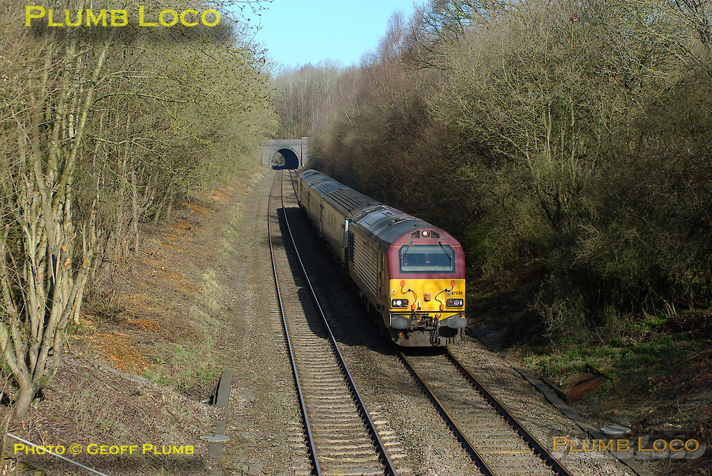 67024 is topping the train while 67003 is tailing, 5Z63, the 08:33 Banbury to Marylebone WS&MR training run, having just emerged from the short Brill Tunnel at 09:01 on Thursday 27th March 2008. The date on the tunnel is 1909, the Bicester cut-off line was not opened by the GWR until 1910. Digital Image No. IMGP4106.