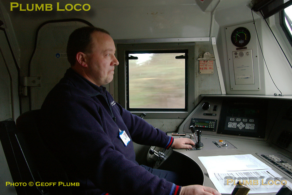 "Chiltern Driver Nigel Byrne was ""in the seat"" for the return run from Marylebone to Banbury, though Steve Roast took over for the final part of the trip. Here, Nigel watches the road ahead soon after departing from a station stop at High Wycombe, 16:47, on board 67003. Digital Image No. IMGP4299."