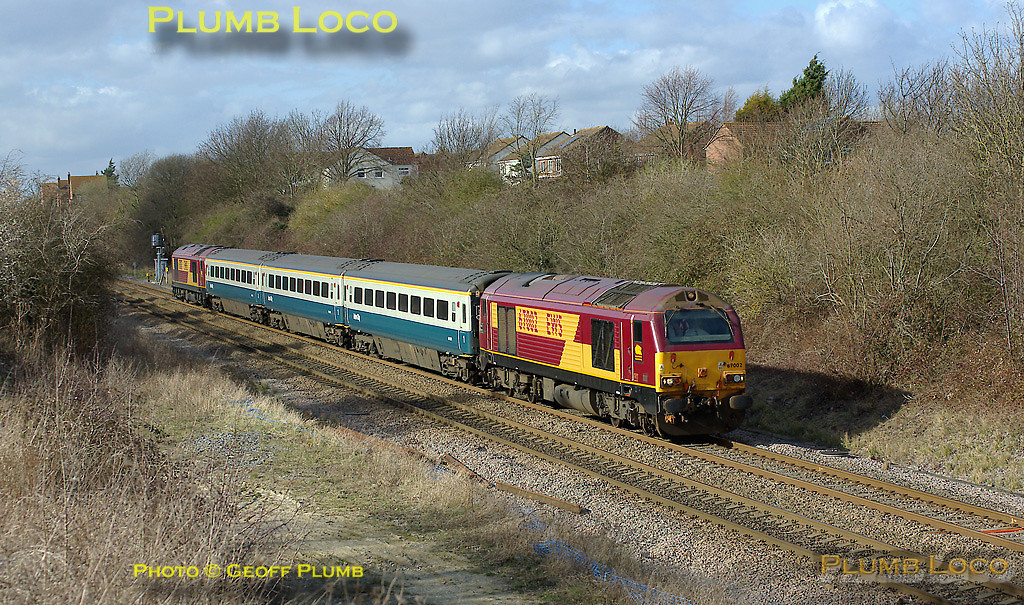 """67002 """"Special Delivery"""" passing the site of the original station in Haddenham at the head of 5Z23, the 14:02 driver training special from Banbury to Marylebone for the Wrexham & Shropshire staff. 67017 """"Arrow"""" is dead on the rear of the train. 14:34, Friday 7th March 2008. Digital Image No. IMGP4037."""