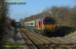 "The afternoon working of the Wrexham crew trainer approaches Haddenham & Thame Parkway station at 14:45 on Tuesday 26th February 2008, topped and tailed by 67017 ""Arrow"" and 67016, with three Cargo-D coaches. This is 5Z23, the 14:02 from Banbury to Marylebone, running in beautiful sunshine for a change! Digital Image No. IMGP3920."