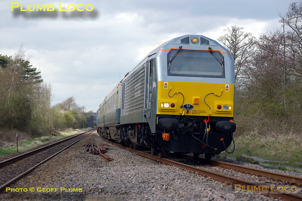 The afternoon up run of the WS&MR training special, 5Z23, 14:02 from Banbury to Marylebone is headed by 67014 in the new W&S livery, with 67013 dead on the rear of the train. This is just south of Dorton, at the point where the up and down lines diverge from each other for the former non-conflicting Ashendon Junction. 14:28, Thursday 10th April 2008. Photo taken from a public footpath across the line, complete with central refuge between the tracks. Digital Image No. IMGP4479.