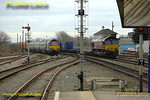 As the Wrexham crew trainer trundles off into the siding south of Banbury station with 67016 & 67017, fellow EWS 66185 passes by with northbound 4M33, the 08:10 Southampton to Burton-on-Trent intermodal service. 11:08, Thursday 21st February 2008. Digital Image No. IMGP3860.
