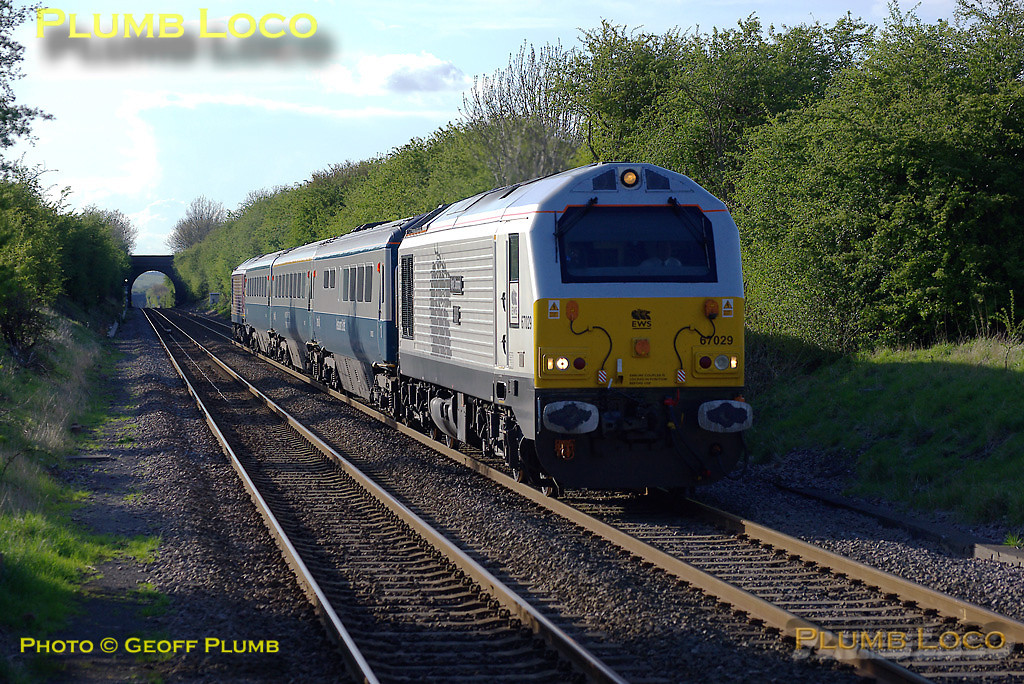 """67029 """"Royal Diamond"""" is leading the train while 67026 brings up the rear as W&S 1P33, the 15:10 Wrexham to Marylebone train, approaches Haddenham & Thame Parkway station a few minutes early at 18:29 on Thursday 1st May 2008, a day of somewhat mixed weather! Digital Image No. IMGP4788."""