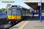 """Green """"bubblecar"""" 121 034 prepares to leave Princes Risborough with its first run carrying fare-paying passengers, the 07:10 train to Aylesbury on Wednesday 25th May 2011. Digital Image No. GMPI9230."""
