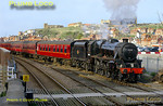 """Having arrived in Whitby with the 16:10 train from Grosmont, """"Black 5"""" 4-6-0 No. 45428 """"Eric Treacy"""" had propelled the stock out from the station to the loop at Bog Hall. After running round the stock, the engine is now propelling it back into the station prior to departure at 17:30 for Pickering. The glorious sunshine picks out the Abbey and St. Mary's church on the East Cliff, 17:17, Saturday 9th April 2011. Digital Image No. GMPI8521."""