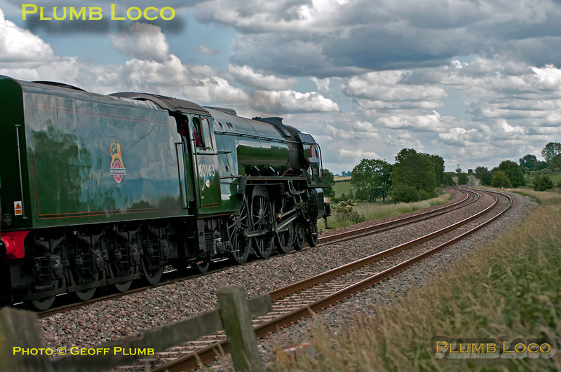 "Having only recently returned to the main line after a major rebuild, A1 4-6-2 No. 60163 ""Tornado"" now carries BR Brunswick Green livery and has been fitted with a lipped double-chimney. It is seen here at Clattercote foot-crossing running as 5Z20 with just its support coach in tow from Crewe to Didcot, a couple of minutes early at 14:24 on Thursday 9th June 2011. Digital Image No. GMPI9414."