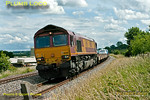66060 heads north at Clattercote foot-crossing with 6M48, the 10:11 car carrier train from Southampton Eastern Docks to Warrington at 14:13 on Thursday 9th June 2011. Digital Image No. GMPI9398.