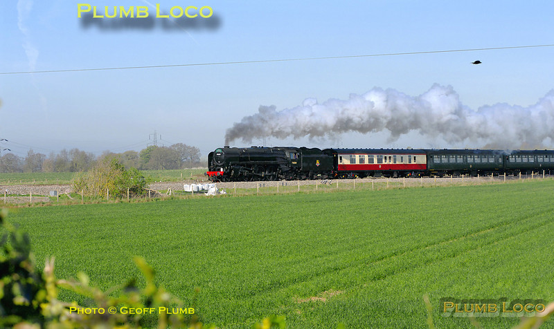 "On its first revenue earning run since its return from overhaul, BR Standard 4-6-2 No. 70000 ""Britannia"" is running in plain black BR livery without its nameplates. It is passing Cholsey Manor Farm with 1Z71, ""The Cathedrals Express"", 09:22 from Oxford to Canterbury and return, a few minutes late at 09:53 on Thursday 7th April 2011. Digital Image No. GMPI8492."
