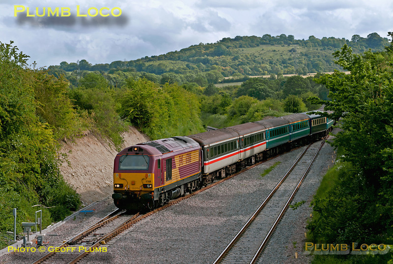 In a fairly unusual move at Princes Risborough, a loco-hauled passenger train, albeit ECS, crosses over from the down line to the up line, to allow a following non-stop Chiltern train to overtake. Hauled by 67008 and with 67019 on the rear of the motley collection of coaches, this is 5Z96, ECS from Wembley Stadium to Eastleigh, having worked a football special from Waterloo to Wembley Stadium for the UEFA Champions League Final. It was routed via Banbury, reverse at Fenny Compton, then Oxford, Reading, Basingstoke and on to Eastleigh... 17:25, Saturday 28th May 2011. Digital Image No. GMPI9317.