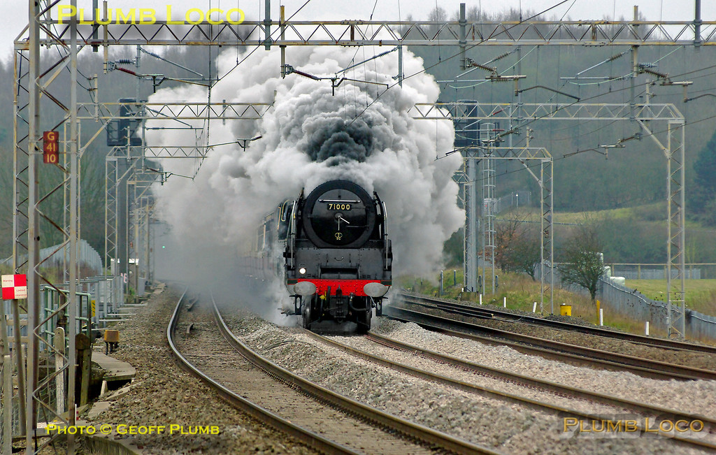 """BR Standard 4-6-2 No. 71000 """"Duke of Gloucester"""" roars along the WCML and leaves a smokescreen over Old Linslade as it heads north on the down slow line with 1Z71, """"The Salopian"""". This was the 07:40 from Euston to Shrewsbury and the train was running around 15 minutes late at 08:46 on Saturday 5th March 2011. Digital Image No. GMPI8106."""