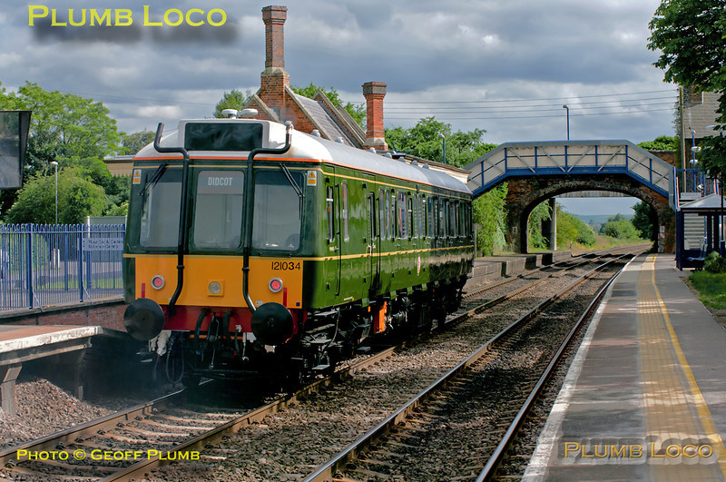 """For a change, the route blind on Chiltern's """"Bubblecar"""" 121 034 is showing the correct destination! It is working as 5Z04, the 15:00 from Aylesbury to Didcot Railway Centre, to go on display for the weekend's celebrations there. It departed from Aylesbury around 20 minutes late but had made up some time once it got going. It is passing the station at Culham at 16:40 having almost reached its journey's end. Friday 27th May 2011. Digital Image No. GMPI9313."""