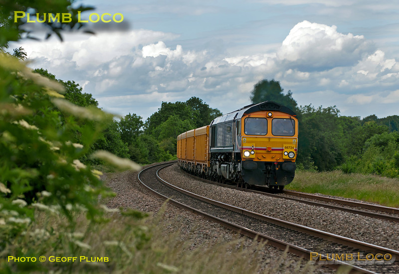 """GBRf 66724 """"Drax Power Station""""  is south bound at Clattercote foot-crossing with 6O96, the 10:27 Mountsorrel to Eastleigh VQ loaded ballest train, 14:21, Thursday 9th June 2011. Digital Image No. GMPI9403."""