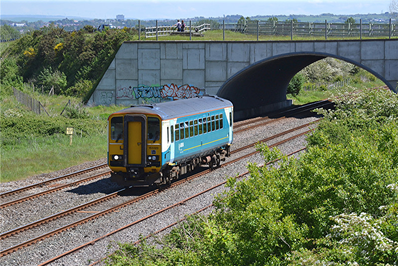 153323 scuttles along working 2M57 13:12 Swansea to Shrewsbury at Llandeilo Junction on 21/5/14 whilst in the background local top veg Julian Rees and Martin Bray can be seen discussing the meaning of life and perhaps more importantly the whereabouts of the late running 1Q14.