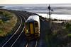 153327 1E18 14:29 Swansea to Pembroke Dock at Ferryside 23/11/14.