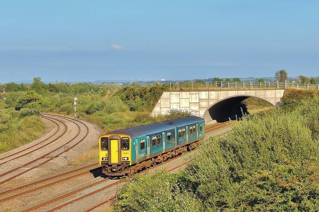 150227 2E31 17:35 Swansea to Carmarthen at Llandeilo Junction 30/8/16.