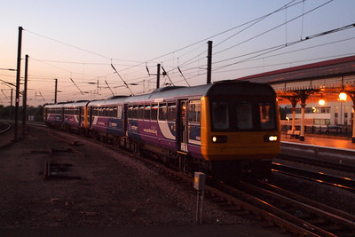 A pair of Northern Rail Class 142s arrive ECS from Knaresborough at York, bound for Heaton TMD, after a reversal. 28/09/11.