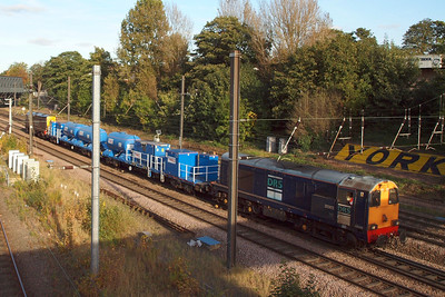 20303 and 20305 pass the York sign on the ECML at Holgate Bridge on 3S21, 07/10/12.