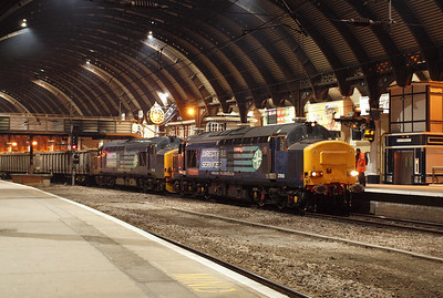 37610 TS Cassady and 37218 sit under the trainshed roof at York on 6Z50 Stockton Thomsons - Sheerness Steel Works scrap train. 02/03/11.