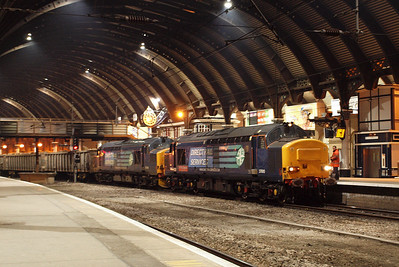 The cathedral-like roof overshadows the two Class 37s on 6Z50. 02/03/11.