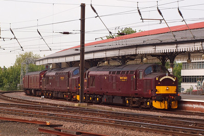 37706 and 37676 Loch Rannoch, working a special charter for the retirement of NRM veteran Ray Towell (hence the Matey's Farewell headboard), arrive in Platform 4 at York from Scarborough. 05/05/11.